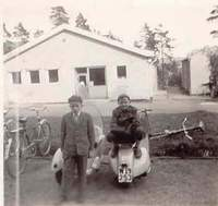 Vespa 125 cc 1953 with me sitting on and brother Sven-Erik standing beside